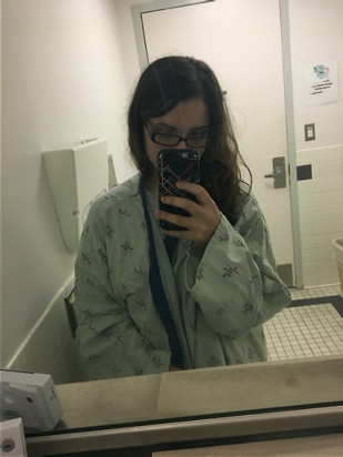 Selina in a hospital gown
