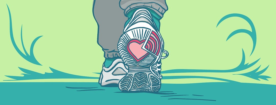 Close up of shoes walking. On the sole there is a heart symbolizing self-love in the form of exercise.