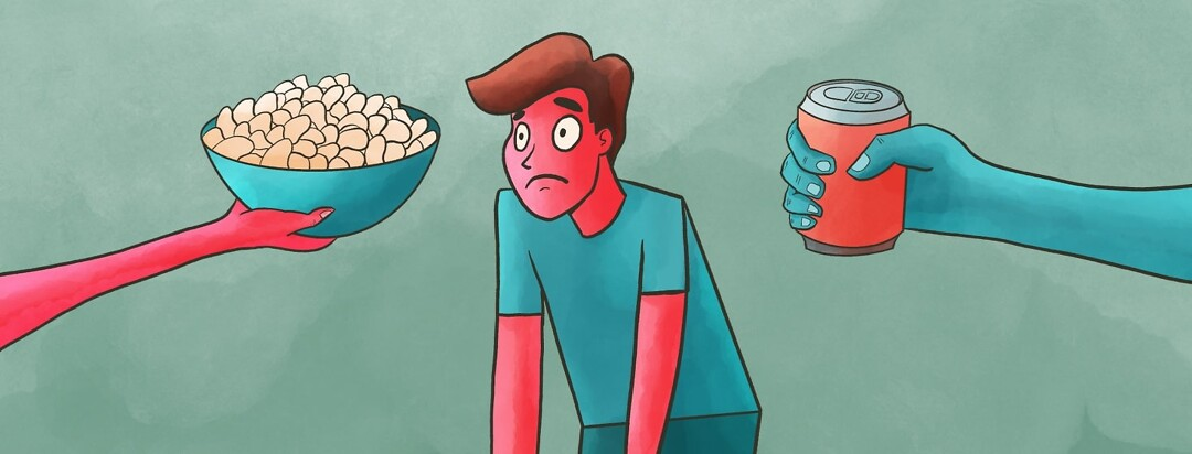person overwhelmed by people overing chips and soda