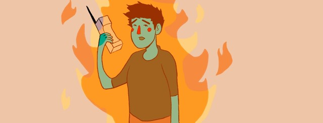 anxious person holding a phone while on fire