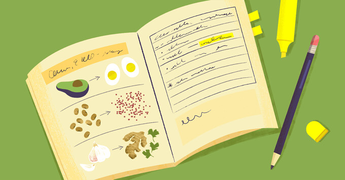 A journal is open and showing drawings of foods and scribbled notes.