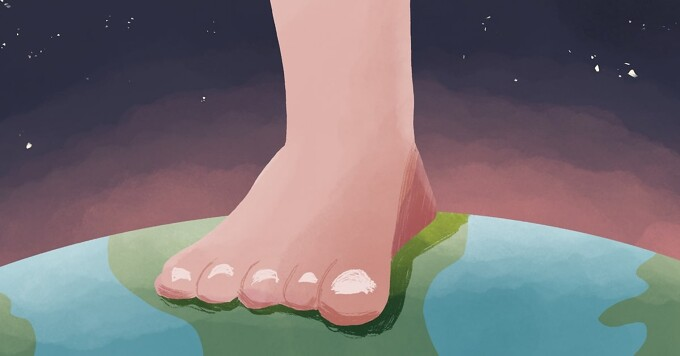 a bare foot standing on the earth