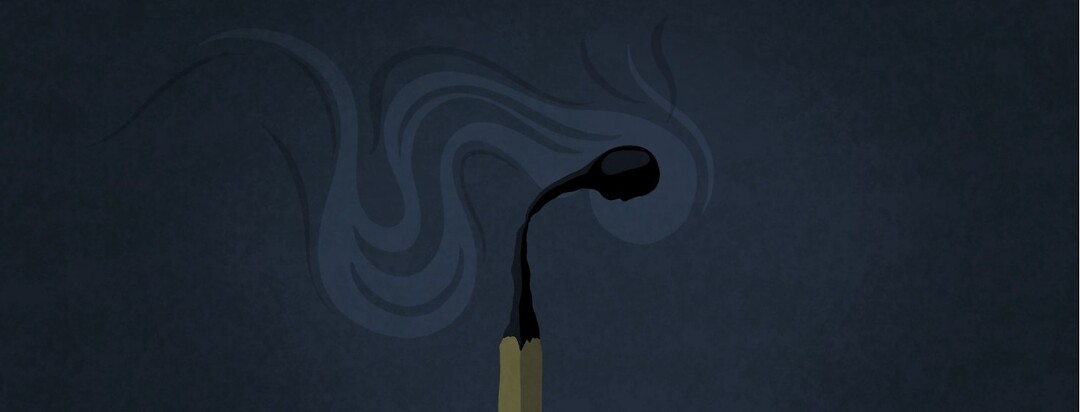 A burnt out and smoking match with a person's profile in the match head