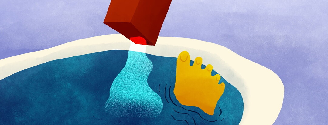 foot sticking out of water in bath tub while epsom salts are being poured in