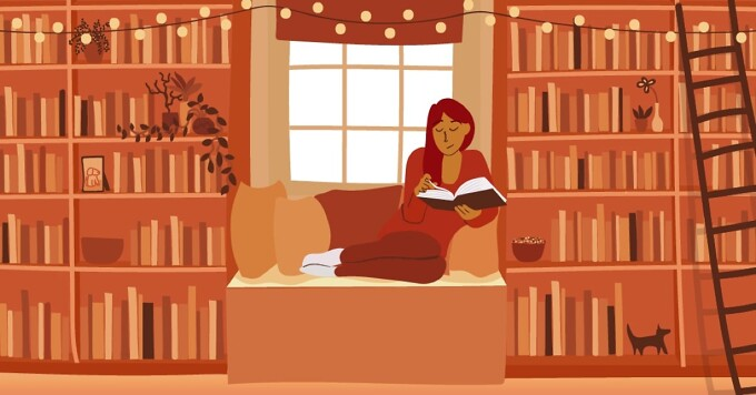 Woman reading book in front of window and bookshelves