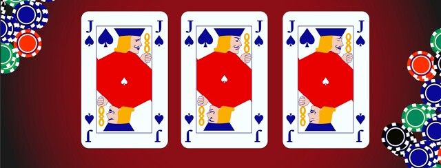 Three joker cards lie on a poker table each with a different facial expression